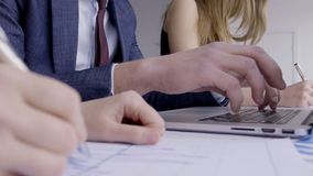 Successful specialists are in working process at table modern office. stock footage