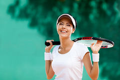 Successful sportswoman with racket Royalty Free Stock Photo