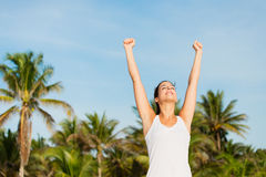 Successful sporty woman enjoying relaxing vacation at the beach Royalty Free Stock Photography