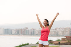 Successful sporty woman towards city scape Royalty Free Stock Image
