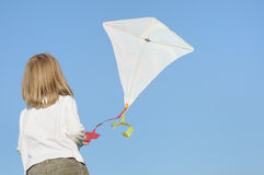 Successful start-up. Kid girl having success in start up kite flying Royalty Free Stock Image