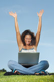 Successful student. Happy student with raised arms at a laptop Stock Photo
