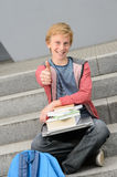 Successful student with books and laptop thumb-up Royalty Free Stock Photos