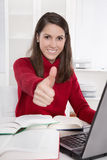 Successful Student in front of her Computer with thump up. Stock Photos