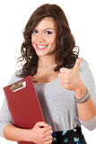 Successful student girl with thumb up and clipboar Royalty Free Stock Photos