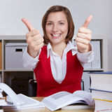 Successful student holding thumbs Stock Image