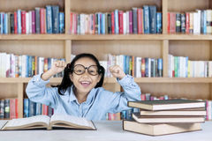 Successful student lifting hands in library Royalty Free Stock Photos