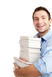 Successful student on white. Portrait of smiling handsome student holding books and looking at camera on white Stock Image