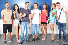 Successful students holding thumbs up Stock Images