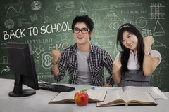 Successful students winning in class 1 Stock Photo