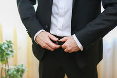 Successful stylish businessman holds his hand on belt Royalty Free Stock Photos