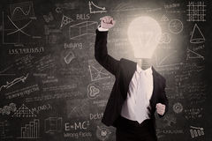 Successful teacher with lightbulb head raised hand in class Royalty Free Stock Photography