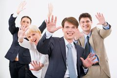 Successful team. Portrait of four successful business people expressing joy Royalty Free Stock Images