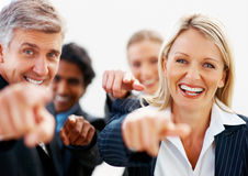 Successful team of business people pointing Royalty Free Stock Photo
