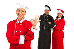 Successful team of chefs. Successful team of chef with women in front of team showing okay sign hand gesture Stock Image