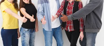 Successful team concept. Confident business people. Successful team show thumb up gesture. Confident successful young people are happy and satisfied, white stock images