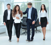 Successful team of coworkers making great meeting discussion in. Business and office concept - smiling business team working  in office Royalty Free Stock Photos