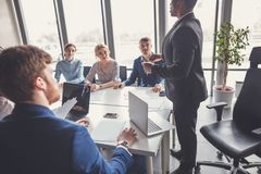 Team leader and business owner leading informal in-house business meeting Stock Image