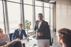 Team leader and business owner leading informal in-house business meeting royalty free stock photography