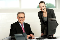 Successful team of senior man and young woman Stock Image