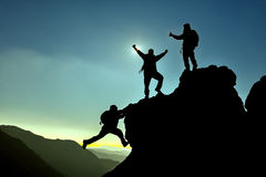 Successful team silhouette. Mountaineering activity.successful team silhouette Stock Photos