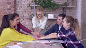 Successful team spirit, happy office workers men and women Hands stacked together moving up and down while Brainstorming. On new business idea development stock video footage