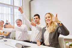 Successful team with thumbs up. Successful business team cheering with thumbs up their success Stock Photography