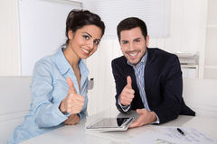 Successful team with thumbs up at office. Stock Photography