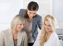 Successful team of well educated businesswoman sitting at desk w Royalty Free Stock Photography