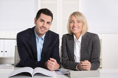 Successful team work: businessman and older female managing dire Stock Photo