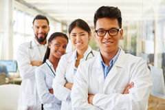 Successful team of young doctors and students. In interracial medical clinic stock photography
