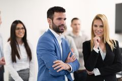 Successful team of young perspective businesspeople in office stock images