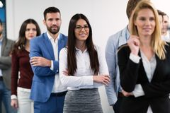 Successful team of young perspective businesspeople in office royalty free stock photos