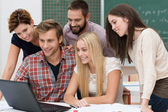 Successful team of young students Stock Photo