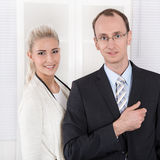 Successful teamwork - man and woman - good cooperation. Stock Images