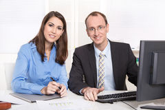 Successful teamwork - smiling man and woman in a blue blouse Stock Photography