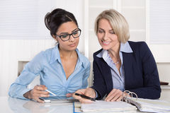 Successful teamwork under businesswoman at desk. Stock Photo