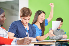 Successful teenage student celebrates. Her test results in class Royalty Free Stock Photography