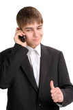 Successful teenager. Cheerful teenager get a good news on the phone Royalty Free Stock Images