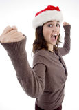 Successful teenager wearing christmas hat Stock Image