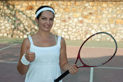 Successful tennis player woman Stock Images