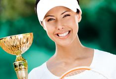Successful tennis player won the competition. Professional tennis player won the cup at the sport competition. Victory Royalty Free Stock Photo