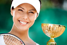 Successful tennis player won the cup. Tennis player won the cup at the sport match. Prize Royalty Free Stock Images