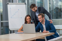 Successful three business partners on the conference Stock Photos