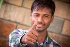 Successful thumb up. Indian Student,Happy casual young student showing thumb royalty free stock photography