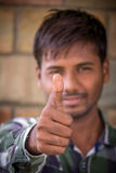 Successful thumb up. Indian Student,Happy casual young student showing thumb Stock Photo