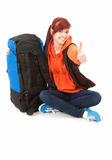 Successful tourist girl with backpack and thumb up Stock Photography
