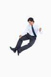 Successful tradesman clicking his heels. Against a white background Stock Images