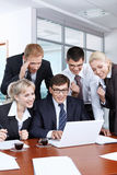 Successful transaction. Young businesspeople in an office happy success Royalty Free Stock Photo