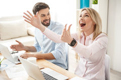 Successful two colleagues are expressing positive emotions Royalty Free Stock Images